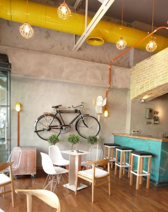 There Is Following Unique Sample Of Interior Design For Who Are Intending To Run A Coffee Shop Hanging Bikes On The Walls